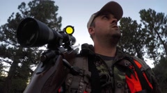 A male hunter walking quietly through trees for deer - stock footage