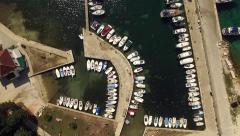 Aerial, vertical - Small port with moored boats Stock Footage