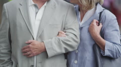 Portrait of happy mature couple outdoors in the city Stock Footage