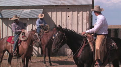 Three Cowboys prepare to rope cattle in northern Nevada Stock Footage