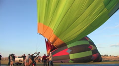 A group of fill there balloon and lift it upright - stock footage