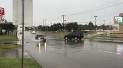 Wide shot of traffic and rain Stock Footage