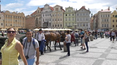 Carriages and tourists in the Old Town Square, Prague Stock Footage