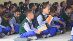 Tibetan children chant mantras in Buddhist school. Dharamsala, India Arkistovideo