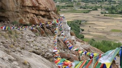 Colorful Buddhist prayer flags in monastery. Ladakh, Jammu & Kashmir, India Stock Footage