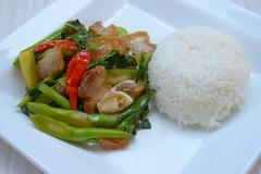 stir fried kale with crispy pork - stock photo