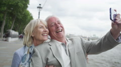 4K Romantic mature couple in London, pose to take a selfie with mobile phone Stock Footage