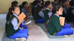 Tibetan children chant mantras in Buddhist school. Dharamsala, India Stock Footage