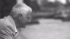 4K Black & white portrait of serious mature man in the city Stock Footage