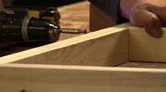 Carpentry . Electric screwdriver . Screwing and fixing on the wood . Stock Footage