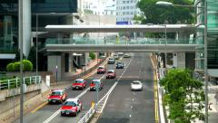 HONG KONG - October 2015: Traffic and skywalk in modern city centre. 4K speed up Stock Footage