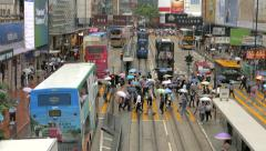 Traffic in Hong Kong with double decker trams in Causeway Bay. Time-lapse Stock Footage