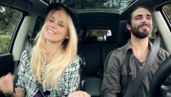 Cool happy hipster couple singing in car Stock Footage