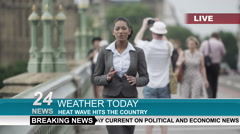 Female weather reporter doing live piece to camera outdoors in the city - stock footage