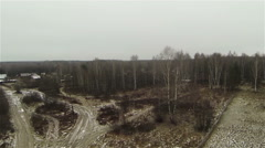 Russian forest during fall and a small settlement. View from the helicopter Stock Footage