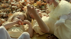 Happy family mother and children in autumn park - stock footage
