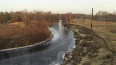 Aerial down flight to autumn icy river Stock Footage