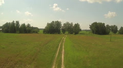Aerial view of road in green red field, sunny day in country side, rissia Stock Footage