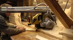 Carpentry.Carpenter sawing wood.Circular saw. Stock Footage