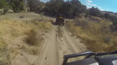 Riding 4x4 off road dusty windy trail following POV HD Stock Footage