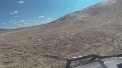 Riding recreation UTV vehicle up sand dune fun POV HD - stock footage