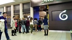 People line up for entering Japanese restaurant inside shopping mall Stock Footage