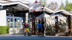 Scoring, basketball net, teenagers, basketball court Stock Footage