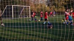 Soccer gate net, soccer training, grass field, teens kicking soccer balls Stock Footage