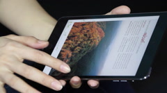 Reading E-book with tablet - stock footage