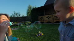 Stock Video Footage of Mother and Son Playing with Soap Bubbles