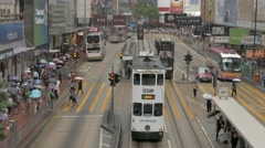 Traffic in Hong Kong with double decker trams in Causeway Bay. View from above. - stock footage