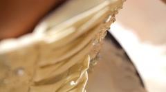 Bridesmaid tying bow on wedding dress Stock Footage