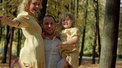 Happy family make a photo in autumn park Stock Footage