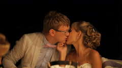 The groom kisses the bride - stock footage