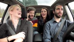 Four cool friends talking on phone smiling in car Stock Footage