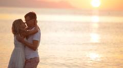 Beautiful couple at sunrise on the island of Santorini Stock Footage