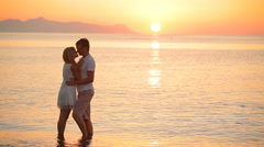 Happy newlywed couple at sunrise Stock Footage