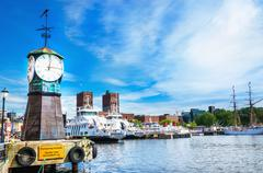 Clock on Aker Brygge dock, modern Oslo in Norway - stock photo