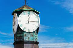 Famous clock on Aker Brygge, modern Oslo, Norway - stock photo