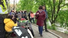 Merchant women sell accessories in fair market near river. 4K - stock footage