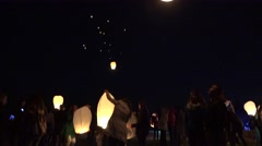 Stock Video Footage of people friends release floating lanterns lamps to sky for make a wish. 4K