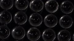 Tilt on bottles wall Stock Footage