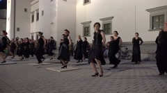 Flamenco woman perform dance with black dress in city square . 4K Stock Footage