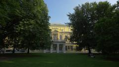 The Zofin Palace seen behind the trees in Prague Stock Footage