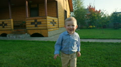 Little Boy Running on the Lawn Stock Footage