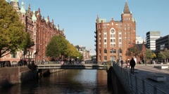 Hamburg Speicherstadt Germany with tourist boat Stock Footage