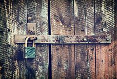 Locked wooden doors close up - stock photo