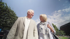 4K Happy romantic mature couple spending time together outdoors in the city Stock Footage