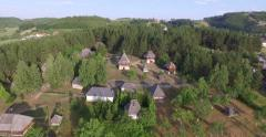 Aerial Slavs Serbian ethnic village in forest in summer Stock Footage