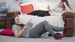 4K Young female friends hanging out at home & looking at computer tablet Stock Footage